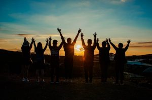 sunset, hands in the air